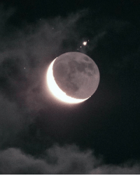 Target, Tumblr, and Blog: ufo-the-truth-is-out-there:Jupiter and 4 of her moons peaking out from behind our moon!