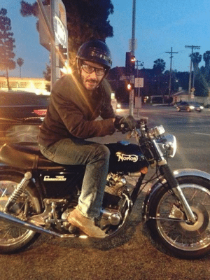 Unapologetic cake day repost of Keanu Reeves on a motorcycle at a traffic light: Unapologetic cake day repost of Keanu Reeves on a motorcycle at a traffic light