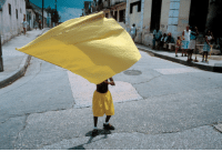 Target, Tumblr, and Blog: unearthedviews: CUBA. Santiago de Cuba. 1998. A young boy carrying a yellow banner during carnival.    © David Alan Harvey/Magnum Photos