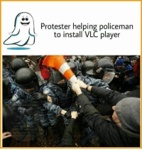 vlc player: UNESCO and  Protester helping policeman  to install VLC player