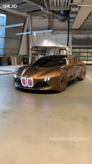 Alive, Bmw, and Dank: UNILAD  SUPERCARBLONDIE The BMW Vision Next 100 has some of the most insane features ever on a car! It actually looks alive! 😱😍  Supercar Blondie
