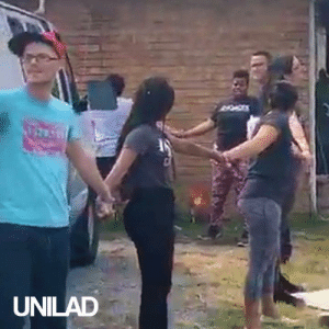 The moment a community formed a human chain in response to ICE agents targeting a father and son without a warrant.: UNILAD The moment a community formed a human chain in response to ICE agents targeting a father and son without a warrant.