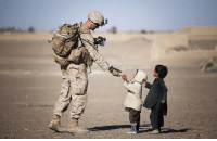 Candy, Iraq, and Mass: US soldier confiscates candy from a child in Iraq to make sure it isnt a Weapon of Mass Destruction, (2003)