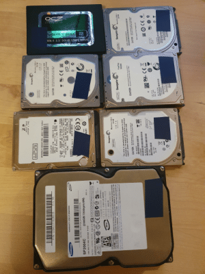 """Maybe wrong forum but anybody knows anything useful to do with these? ~3TB combine, 7200/5400 rpm. (Already have SSD and better HDD in my computer): uskaplogy  OCEtec2oey cem  ATA II 2.5"""" SOLID STATE DRIVE  UNDAS  push cover  Don't shock/  THIS HOLE =>  DO NOT COVER  Seagate  Momentus 7200 3  DO NOT COVEA  BREATHER HOLE  P/N: 1234J1FY628016  250 GB  PTBFS 655-1539F CQ212650C1ZDG5KAR  P/V MS  This drive is manufactured by Seagate for OEM  distribution. For product information or technical  support, please contact your system OEM.  A147121  ® 320GB 2.5inch AT 9.5mm  Apple HDD FI rmware 2010  P/N: OJ13963 MLC: DA3846  CAUTION: Avoid excessive shock do not push on  lop cover or remove any seal or label.  WARRANTY VOID IF REMOVED  Storage Technologies (Thai land).Ltd. TD  MADE IN THAILAND BY Hitachi Global  5V 700mA DC 320GB SATA  9NNSWVS  SCREW IS REMOVED OR BROKEN  WARRANTY VOID IE ANY LABEL JUN-11  LUCOS -3  HTS545032B9A302  HDD:5K500 B-320 C P/N: H2T32085-S  5400RPM  TYPE TS5SAA320  SP2004C  +5V 0.62 A  (200GB/7200rpm/8M)  09241  D33373  ecOOL u - XIs  LBA 390.721,968 200.0G6 P120S  REV. A  RATED : +12V/+5V, 0.5A. 0.7A O  CEE  SAMSUNG ELECTRONICS CO., LTD  02 03 04 05 06 07 08 09 10  20  HITA  11 12 13  www.  1.  100--0084  4.  B.  7.  1.  11 12  US  DA  1.기기의 명칭(모델명) 하드0스크드리이브 (SP2004C)  2.인 증 빈 호: E-H011-05-0399(B)  3.인증받은 자의 상호: 삼성전자 주식회사 구미2공장  4. 제 조 년월 일: 2005.06  5. 재조자/제조국가: 삼성전재(주) 구02공장 / 대한민국  WARNING DELICATE PRODUCT SENSITIVE PARTS INSIDE DAMAGE MAY OCCUR IF SHOCKED.  SERIAL  1606P13  N363 D33475  SHOY  AJ  juedo)  Jumper Pin Setting  9/99C  SATA 15Geps  mode Setting  TOUCHING THE CIRCUITS MAY CAUSE MALFUNCTION, REMOVAL OF THIS COVER WILL VOID  Seagate  ANY AND ALL WARRANTIES.  Product of KOREA  t10NC0C  http://www.samsunghdd.com  취급주의 이제문은 D세한 총격과 정전가에도 손상 될 수 있는 매우 민감한 정밀제품이므로 취급 시 주의 바랍니다. 충격과 정진기에  e 8 eRuBDOM COM, OMD. GAM NEM) HA A/S 12 http://www.samsunghdd.co.kr  DO NOT COVEA  BREATHER HOLE  Momentus 7200.2  120 GB  Product of Chine  DO NOT COVER"""