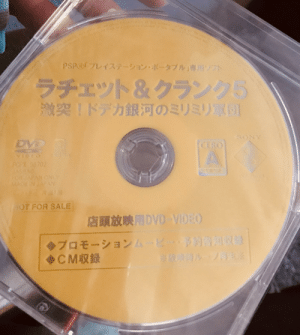 Sony, Help, and Japan: uston dcking traitare. coft  tant Bathat and.0fak l o tccitstered tadeark  PSP@「プレイステーション·ポータブル」専用ソフト  ラチェット&クランク5  激突!ドデカ銀河のミリミリ買団  SONY  DVD  CERO  A  VIDEO  PCPX 96702  FCR JAPAN ONLY  MACE IN JAPAN  ai  OT FOR SALE  店頭放映用DVD VID:O  ATA  NCARA 2X  >プロモーションム1  >CM収録  be os Help! Can anyone identify this Gaming DVD release? More details in comments.