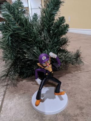 "Uttering a solemn ""wah"", Waluigi puts away his Christmas tree, as the Christmas season now draws to its end.: Uttering a solemn ""wah"", Waluigi puts away his Christmas tree, as the Christmas season now draws to its end."