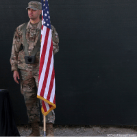 In the first photo, a U.S. Army soldier holds a flag during the change of command ceremony. Incoming U.S. Army Gen. Austin Miller, center, receives Resolute Support's flag from outgoing U.S. Army Gen. John Nicholson, left, during the change of command ceremony at Resolute Support headquarters, in Kabul, Afghanistan, on September 2, in the second photo.: uUS  AP Photo/Massoud Hossaini In the first photo, a U.S. Army soldier holds a flag during the change of command ceremony. Incoming U.S. Army Gen. Austin Miller, center, receives Resolute Support's flag from outgoing U.S. Army Gen. John Nicholson, left, during the change of command ceremony at Resolute Support headquarters, in Kabul, Afghanistan, on September 2, in the second photo.