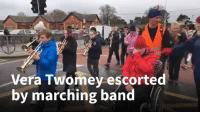 Vera Twomey escorted  by marching band