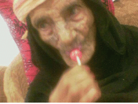 VERY old woman sucking a lollipop at incredible hihg speed: VERY old woman sucking a lollipop at incredible hihg speed