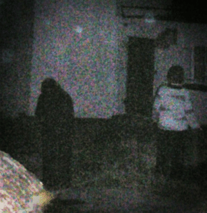 Smoking, Taken, and Tumblr: vigwig:  ooky-spooky-lou: sixpenceee: Taken in 2009 outside the lighthouse keepers cottage at Blackhead lighthouse, County Antrim, UK. Laura snapped a photo of her friend smoking in the dark, believing they were the only people outside the building. That is, until they reviewed their pictures and noticed the dark robed figure standing right in front of them. That's a banshee like.   (Also Antrim is in Ireland…)  Antrim is northern Ireland. The north most county. Banshee indeed.