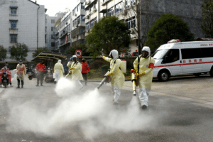 Volunteers in protective suits disinfect a residential compound in Zhejiang province, China, on Jan 30, 2020. Zhejiang has the highest number of coronavirus cases outside Hubei.PHOTO: REUTERS: Volunteers in protective suits disinfect a residential compound in Zhejiang province, China, on Jan 30, 2020. Zhejiang has the highest number of coronavirus cases outside Hubei.PHOTO: REUTERS
