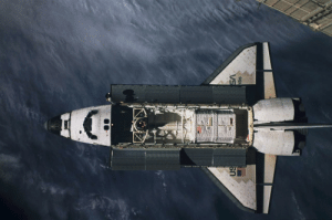 space-pics:  View of the approach of the STS-79 orbiter Atlantis during its docking with the Mir space station. The Spacehab double module, a first time space flyer, is seen in the aft payload bay. Its tunnel can be seen connecting to both Atlantis' crew cabin and the androgynous docking adapter.[4013 × 2661]: VS  htis space-pics:  View of the approach of the STS-79 orbiter Atlantis during its docking with the Mir space station. The Spacehab double module, a first time space flyer, is seen in the aft payload bay. Its tunnel can be seen connecting to both Atlantis' crew cabin and the androgynous docking adapter.[4013 × 2661]