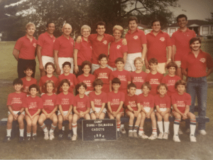 Anyone you know? Found in an old box, I am the 4th lower row. Do not know anything else. Would be nice to find someone else in this pic. This summer camp was in NY, 1984.: w*  CAMP  CAMP  GAMP  ALAMAQU  MAG  OYHTH  CAMP  61MAQU  CAMP  CAMP  CA  CAMP  IPRAGUE  CAMP  SLAL  CAMP  DALP G  SAMP  CAMP  TLMAOUA  CAMP  AAQU  CAMP  MACE  AHP  CARP  DAL  AHT  CAMP  DIANA-DALMAQUA  CADETS  984  FST Anyone you know? Found in an old box, I am the 4th lower row. Do not know anything else. Would be nice to find someone else in this pic. This summer camp was in NY, 1984.