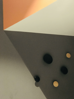 Hotel, Room, and  Wall: wall hangers and shadows in my hotel room