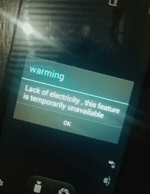 Phone, Electricity, and This: warming  Lack of electricity, this feature  is temporarily unavailable  OK My phone needs to warm up and it needs electricity