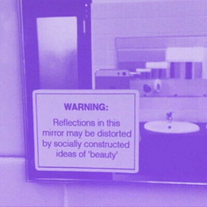 Mirror, Ideas, and May: WARNING:  Reflections in this  mirror may be distorted  by socially constructed  ideas of 'beauty