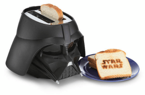thecoolstuffs:  Star Wars Darth Vader Toaster, The alarm goes off. Vader gets up, stretches, and slogs out of bed. He puts on his Star Wars Fleece Robe and his Darth Vader slippers, and heads to the kitchen. Of course he enjoys a cup of Dark Side Roast, but Vader never, EVER starts his day without some toast made in his Star Wars Toaster.  Star Wars Darth Vader Toaster     $49.99   I want this!  The *Cool Stuffs!: WARS thecoolstuffs:  Star Wars Darth Vader Toaster, The alarm goes off. Vader gets up, stretches, and slogs out of bed. He puts on his Star Wars Fleece Robe and his Darth Vader slippers, and heads to the kitchen. Of course he enjoys a cup of Dark Side Roast, but Vader never, EVER starts his day without some toast made in his Star Wars Toaster.  Star Wars Darth Vader Toaster     $49.99   I want this!  The *Cool Stuffs!