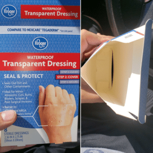 """Well played, Kroger. Well fucking played.: WATERPROOF  kroger Transparent Dressing  COMPARE TO NEXCARE"""" TEGADERMT See side panel  Mroger  WATERPROOF  Transparent Dressing  STEP 1: CLEAN  SEAL & PROTECT  STEP 2: COVER  STEP 3: SECURE  Seals Out Dirt and  Other Contaminants  Ideal for Minor  Abrasions, Cuts, Burns,  Blisters, Scrapes, &  Post-Surgical Incisions  Barrier to  nd MRSA  oratory Testing**  STERILE DRESSINGS  2.36 IN X 2.75 IN  (59mm X 69mm) Well played, Kroger. Well fucking played."""