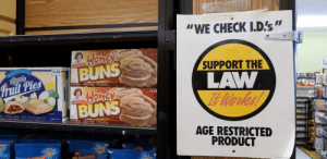 """Funny, Little Debbie, and Law: WE CHECK I.D's""""  Little Debbie  BUNS  SUPPORT THE  $3.09  ruit Pies  LAW  $1.79  BUNS  AGE RESTRICTED  PRODUCT  1.99  1.99  Little Debbie Damn these new laws are getting out of hand"""