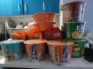 We live in Beijing which is currently dealing with the Coronavirus so most people are staying at home and most shops are closed. The shop across from us was concerned that we would not have food so they sent us 2 grocery bags of instant noodles.: We live in Beijing which is currently dealing with the Coronavirus so most people are staying at home and most shops are closed. The shop across from us was concerned that we would not have food so they sent us 2 grocery bags of instant noodles.