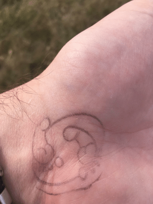 Went to a pumpkin patch with my family earlier this year. My mom got mad because she couldn't figure out why my sister and I were laughing so hard about the wrist stamps to gain entry. They're supposed to be footprints.: Went to a pumpkin patch with my family earlier this year. My mom got mad because she couldn't figure out why my sister and I were laughing so hard about the wrist stamps to gain entry. They're supposed to be footprints.