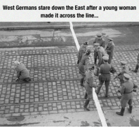 History, Down, and Woman: West Germans stare down the East after a young woman  made it across the line. <p>A Part Of Our History.</p>
