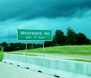 Democrats erect signs to spread awareness of Manifest Destiny (1840, colorized): Westward Ho  Exit 1 MILE Democrats erect signs to spread awareness of Manifest Destiny (1840, colorized)
