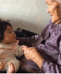 When great-grandma meets great granddaughter for the first time.: When great-grandma meets great granddaughter for the first time.