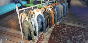 Why are these on the sale rail yet not actually in the game as a wearable item? The dark blue one is literally the only jacket I want for my character.: Why are these on the sale rail yet not actually in the game as a wearable item? The dark blue one is literally the only jacket I want for my character.