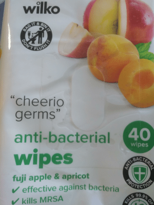 """How to clean in British: wilko  W  BAG IT & BIN  DON'TFLUSH  cheerio  germs""""  66  anti-bacterial40  wipes  wipes  fuji apple & apricot  effective against bacteria  NOTECTION  KILLS 99.9% 0F  kills MRSA  IT  T  ERIA  ANTI How to clean in British"""