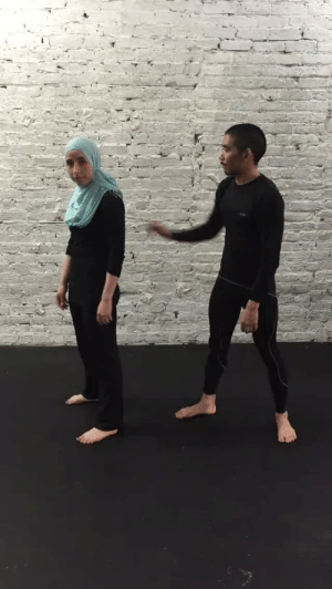 Click, Crime, and Facebook: witchymoonhag:  witchymoonhag:  blueandbluer:  aishawarma:  Learn to defend against a bigot grabbing your hijab from behind! In this post-election hate-crime spike, self defense is more important than ever. Practice this move until it becomes muscle memory and teach your body to react before thinking. (via Zee Abdulla)  Signal boost. Anyone know if this would work equally as well if he grabbed with his other hand? I feel it wouldn't, but it's still better than nothing.   If the attacker used the other hand, then the woman wearing the hijab could use the opposite arm than is shown. SO PRACTICE BOTH SIDES.  Also please note the position of her arm on his. It's not on the elbow but just above it. That is will be important for the submission. The grip on her hand is important as well. It looks like she is using a monkey grip where the thumb stays with the fingers of the hand instead of wrapping around. It protects your thumb from being broken and can be a stronger grip in general.  But yes, practice practice practice practice  Btw, if you click on her name, Zee Abdulla, in the post it takes you to her Facebook where she has another video for a defense for a front hijab grab.