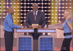 Family, Family Feud, and Man: Woman tries to distract man on Family Feud