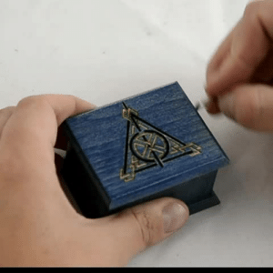 Harry Potter, Music, and Target: woodissimo:Harry Potter music box in Woodissimo Shop 5% OFF with coupon code SECRETDISCOUNT Harry Potter Deathly Hallows music box blue - soundtrack and design inspired handmade and hand-powered wooden music box woodissimo.etsy.com