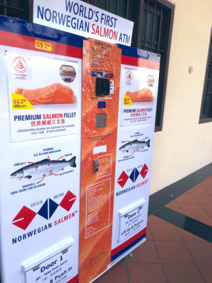 """Does discount as Late stage capitalism?: WORLD'S FIRST  NORWEGIAN SALMON ATM  S$290  STEPS TO BUY  HEALTHIER  1)Press 1 or 2 and Enter  购物流程  选择1成2号,按确认健,  2) Tap or swipe cashless card to pay  Health  Board  Lower in Sodium  Promotion  副卡支付。  3)  Take product from Door 1.or Doar 2  1 Take product from Door  BRI, HIejER.  w sdum  #2 Take product an Dre  Accept Debit / Credit Cards  204 14  EAL  S$ 20  (200g NET)  pass  Lover in Sodum  VISA  Machine ID LS-4108 Oh al Liehts Salmoni  PREMIUM SALMON FILLET  S$ 20  (200, NET)  优质挪威三文鱼  (FROZEN RAW SALMON, NO ADDITIVES OR FLAVOURS)  PREMIUM SALMON FILLET  冷冻三文鱼,全天然无任何添加剂  优质挪威三文鱼  (FROZEN RAW SALMON, NO ADDITIVES OR FLAVOURS)  冷冻三文鱼,全天然无任何添加到  For support, callams 00S SO2 during ofica bour ManFl dundpe  Afar office hour, please SS un the Machine A  We will revert on next working day  VITAMINS  A,D, B12 AND RIBOFLAVIN  VITAMINS  AD, B12 AND RIBOFLAVIN  OMEGA 3  OMEGA 3  PROTEIN  PROTEIN  Storage Instruction  Caep Storage (-18)  nce thawed, dont refreeze  SUSTAINABLE  MINERALS  IRON, IODINE AND SELENIUM  SUSTAINABLE  heit Lite  rozen (-18c) 24 monthy  hilled (2-Sck 3 days  MINERALS  Caution  May contain fine bones  IRON, IODINE AND SELENIUM  MATERS  ORIGIN  Nutritional content per 100y  MATTERS  farmed salmon.  Energy: 932 kJ/224 kcal  rolein: 20 g  Fat: 14 g  Saturated faty acids: 39  Cis-mono unsaturated fatty acids: 5.og  Cis-poly unsaturated fatty acids: 59  ORIGIN  NORWEGIAN SALMON""""  Catty acids: 3.6 g  fatty acids: 1.2g  Vitamin A 26 RAE  Vitamin A 10 ug  Ribolavin: 0.11 mg  Vitamin B12: 3.5 ug  Vitamins:  NORWEGIAN SALMON  Door 2  Minerals:  enlum: 30 pg  Sala 12  Iron: 0.3 mg  (#2: Take from here)  Lift Up & Push In  (#1: Take from here)  1号:在此取货  & Push In  デ往内推  Door 1  FOR BULK ORDERS  PLEASE VISIT OUR WEBSITE  www.norwegiansalmon.com.sg  CHOICE Does discount as Late stage capitalism?"""