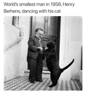 Smallest: World's smallest man in 1956, Henry  Berhens, dancing with his cat
