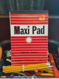 maxi pad: WRITING TABLET  100 SHEETS  6in. x 9in.  UNRULED 4921  MANUFACTURED BY SANGAMON CO . TAYLORVILLE, ILL. 62568. VISALIA. CALIP  HE  STAPLES