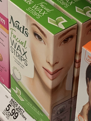 Stop putting faces like this: X  PIPS  Facial  SWAX  STRIPS  NE  Nads  Fucial  WAX  STRIPS  Removal  mess  Free  Touchable solt.  Up  Hoir Renein ny  4144  SMO  aE A WAM  JUST RUe, PEEL & GO  UP TO 8VEEKS C F SMOOTH SKIN  1570  NADS 24CT  FACIAL WAX STRIPS  21031  5.99  048 06 0885  243.090 001  60885 07/18 Stop putting faces like this