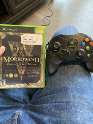 """My work gives us 2 weeks off for Christmas so I bought myself an OG Xbox and Morrowind to keep myself busy: XBOX  NTSC  Jays CD and Hobby  ELDER SCROLLS 3 MORROWIND  Xbox  12/1/2019  USED  XBOX  $16. 99 3 78  093155118300  XBOX  The Elder Scrolls III  BACK  MORROWIND  ETAR  Game of the Year Edition  ALL NEW CONTENT FROM  RPG OF THE YEAR  The Elder Berolls III  GAME OF THE YEAR  BLOODMOON  SDy  The Clder Serolls III  2002  GAME O  THE YEAR  TRIBUNAL  PC RPS  es E PLaTING GA  TEEN  """"Bethesda  SOFTWORKS  CONTENT RATED BY  ESRB My work gives us 2 weeks off for Christmas so I bought myself an OG Xbox and Morrowind to keep myself busy"""