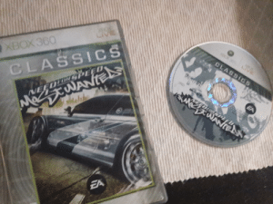 Phone, Taken, and The Game: XDCKE  CIV  CLASSICS  XBOX360  S WANTE  VEEDLDRPEED  CLASSICS  SPEEL  VEEDLO PEE  Nee3WANIEN I just got NFS Heat so I thought I should show you people the game that got me obsessed with the franchise (picture was taken from my phone)