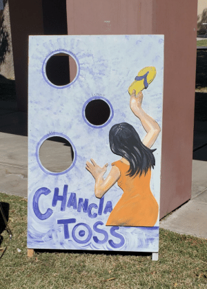 I work at a predominantly Latino school and this is one of the games set up for their fall festival today lol: youk  EXPERT  ఉh  CHANGA  HAం  TOSS I work at a predominantly Latino school and this is one of the games set up for their fall festival today lol