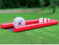 Memes, 🤖, and Bowling Balls: YupThatExists.com The human bowling ball game sends players rolling down a blown up lane in a human sized