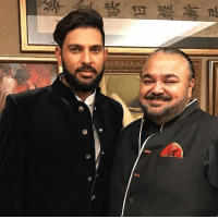 Yuvraj Singh poses for a pic with fashion designer JJ Valaya while trying his wedding clothes.: Yuvraj Singh poses for a pic with fashion designer JJ Valaya while trying his wedding clothes.