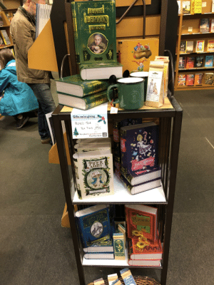 Our local bookstore has some incre-tea-bly punny tea tins.: Z ZADIE  SA SMITH  SV SWING  OLIVER  LEMON  cELINETI TIME  WOODSON  STWIST  THE  FAISN  DRY  JANE  nox o.  tu talk  Cbeur  race  STILL  LIFE  NOVELTE  SENSE AN  SENCHABILITY  GIEAVT  HOA  bigredian Cres Tis Se ha  25  OLE  Gifts we're giving  NOVEL-TEA  TEA TINS  ANISE  EP IN  Your place for great discoveries. THIRD  PLACE  Third Place Books BOOKS  ONDER  LAND SE  DER  ND  PUER  RABBIT  ANISE WDRAND  ATEA INSPIRAD BY A VERY NAUGHTY RARIT  THE PICTURE  FARL GREY  MATCHA DO-  OF  140  PEKOE  PAN  THE PICTURE  OF  EARL GREY  LSIMI Our local bookstore has some incre-tea-bly punny tea tins.