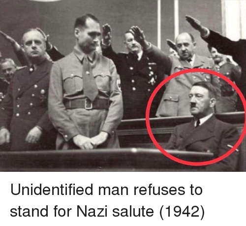 Man, For, and Stand: Unidentified man refuses to stand for Nazi salute (1942)
