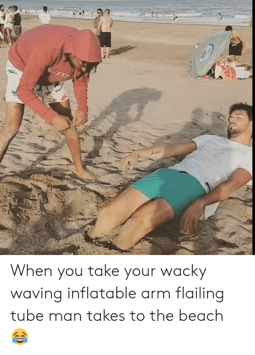 Beach, Tube, and Arm: When you take your wacky waving inflatable arm flailing tube man takes to the beach 😂